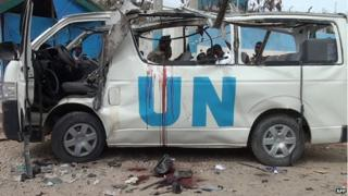 Blood is seen in the shell of a UN van following a bomb attack