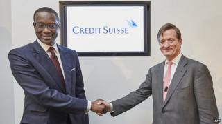 Credit Suisse CEO Brady W. Dougan (R) and Credit Suisse designated CEO Tidjane Thiam shake hands at the end of a press conference on March 10, 2015 in Zurich