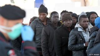African migrants arrive in the Italian port of Augusta, Sicily, 16 April, 2015