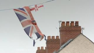 A union flag tattered by prolonged exposure to the weather