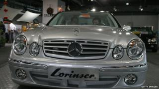 Two customers sit in a Mercedes-Benz at a luxury car showroom, May 11, 2004, in Beijing, China.