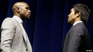 "Eleven-time, five-division world champion Floyd ""Money"" Mayweather (L) and eight-division world champion Manny ""Pac-Man"" Pacquiao attend a press conference in Los Angeles, California March 11, 2015"