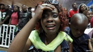 A woman reacts after seeing her sister who was rescued from the Garissa University attack in Kenya's capital Nairobi 4 April 2015