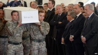 EU Commissioner on Migration Dimitris Avramopoulos (right) and Italy's Interior Minister Angelino Alfano (second right) attend an interfaith funeral ceremony of 24 migrants who died off the Libyan coast on 23 April, 2015