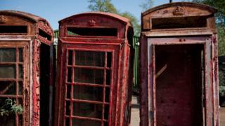 Three derelict phone boxes