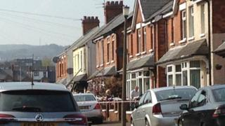 A police cordon was put in place at the scene of the fire in Rosapenna Parade