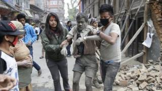People free a man from the rubble of a destroyed building after an earthquake hit Nepal, in Kathmandu, Nepal, 25 April 2015.