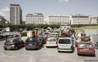 Cars belonging to Tunisian immigrants wait at the port to board the ferry that connects Palermo and Tunis