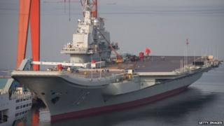 Chinese aircraft carrier Liaoning docked at the seaport city of Dalian