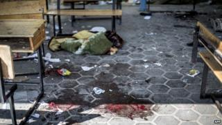 Aftermath of reported shelling of UN school in Beit Hanoun in the northern Gaza Strip (24 June 2014)