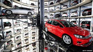 A Volkswagen Passat and Golf 7 car stored in a tower at the Volkswagen Autostadt complex near the Volkswagen factory on March 10, 2015 in Wolfsburg, Germany