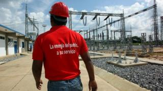 October 2, 2008 shows employees of the Venezuelan national electricity company inside an electric plant in San Fernando de Apure (southern Venezuela).