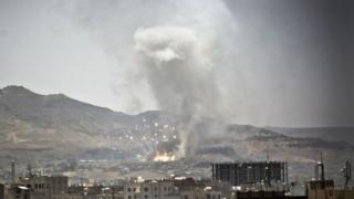 Smoke rises after a Saudi-led airstrike hits a site where many believe the largest weapons cache in Yemen's capital, Sanaa