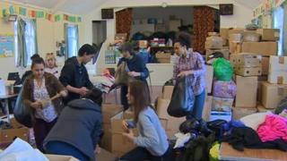 Volunteers pack donations for Nepal