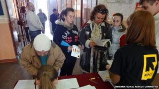 AN IRC team distributes women's hygiene and safety equipment in eastern Ukraine