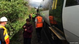 Passengers being evacuated from a train