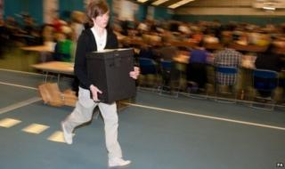 Ballot boxes are run in during Sunderland election count in 2010