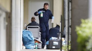 German police officers secure evidence in front of an apartment in Oberursel, Germany, on 30 April 2015.