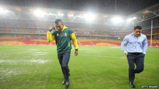 Will Chamber and Cooper Cronk inspect the field before the Trans-Tasman Test match between the Australia Kangaroos and the New Zealand Kiwis at Suncorp Stadium on 1 May 2015 in Brisbane, Australia.