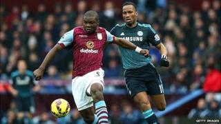 Jores Okore of Aston Villa battles for the ball with Didier Drogba of Chelsea