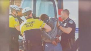 A still from amateur video footage that showed Gray being handcuffed and pushed into a police van