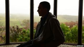 A man silhouetted in a window