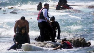 Migrants, who are trying to reach Greece, are rescued by members of the Greek Coast guard and locals near the coast of the southeastern island of Rhodes 20 April 2015