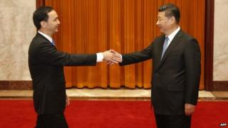Eric Chu (L), chairman of Taiwan's ruling Kuomintang (KMT) party, shakes hands with Chinese President Xi Jinping during a visit to the Great Hall of the People in Beijing on May 4, 2015