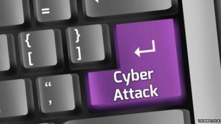 """A computer keyboard with a key marked """"Cyber Attack"""""""