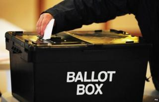 A vote is cast into the ballot box