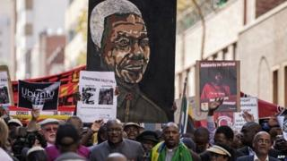 Thousands march against the recent wave of xenophobic attacks in South Africa through the streets of Johannesburg on 23 April 2015