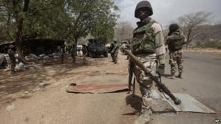 Nigerian Soldiers man a check point in Gwoza, Nigeria, a town newly liberated from Boko Haram