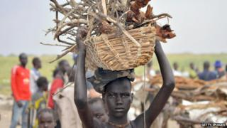 An internally displaced girl carries firewood in Ganyiel village of Panyijar County of Unity State on March 21, 2015