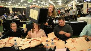 Counting staff work at the counting centre at Doncaster Racecourse, northern England, on May 7, 2015