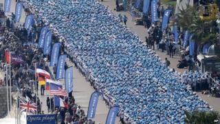 Employees of the Tiens Group attend a parade organised as part of a four-day celebration weekend for the 20th anniversary of the company on the Promenade des Anglais, Nice, France on 8 May 2015