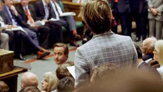 David Cameron looks towards a backbench MP in the Commons during the 2010-2015 Parliament