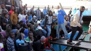Migrants disembark from a boat after the Libyan coastguard intercepted a boat with African migrants trying to reach Europe at the port in the city of Misrata east of Tripoli, Libya, 03 May 2015