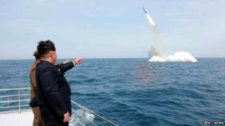 An image obtained by Yonhap News Agency showing North Korean leader Kim Jong-un pointing at a ballistic missile believed to have been launched from underwater near Sinpo, on the northeast coast of North Korean, 09 May 2015