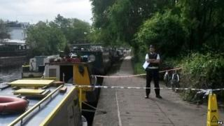 Policeman standing by the canal