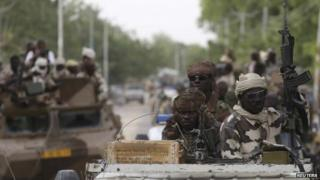 Chadian soldiers drive in the town of Damasak, Nigeria, 18 March 2015
