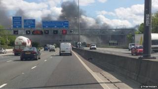 smoke billowing across the M25