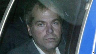 John Hinckley Jr, shown here in 2003, is inside of a car