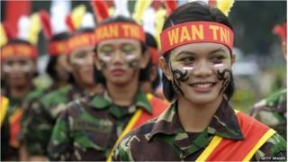 Female members of the Indonesian armed forces perform during a Kartini day ceremony