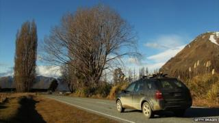 A car driving along a road in New Zealand