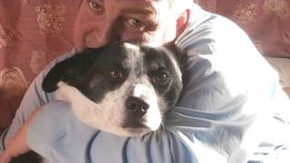 Garry Betts with his dog, Buster