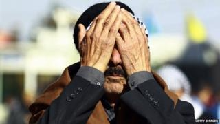 An Iraqi mourns the death of his son in Ramadi.