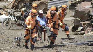 Rescue workers help a victim of an avalanche in Salgar on 19 May, 2015.