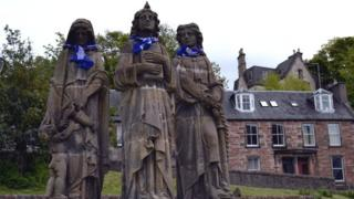Statues wearing scarves