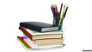 School books and pot of pens and pencils