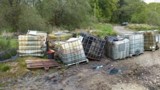 Containers of the sludge were dumped on the road